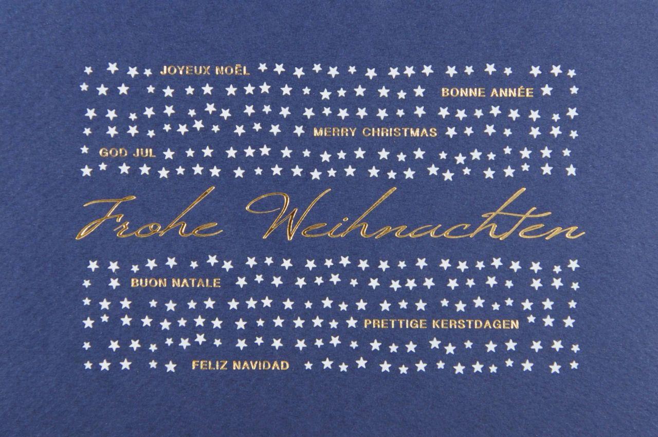 Blaue Weihnachtskarte mit Einleger und Kuvert.